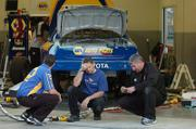 Above, Crew members for driver Michael Waltrip, take a break from preparing his backup car for the Daytona 500 in February. NASCAR officials confiscated the primary car of the No. 55 Toyota team because of rule violations.