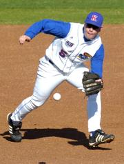 Kansas University's Matt Berner snags a grounder against Kansas Wesleyan. The Jayhawks rolled to an 11-4 victory Wednesday at Hoglund Ballpark. Story on page 1C.