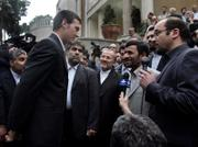 Nathan Summers, left, one of 15 British navy personnel seized by Iran, talks with Iranian President Mahmoud Ahmadinejad, center right, in Tehran. Ahmadinejad announced Wednesday that his government would release the detained sailors and marines as an Easter season gift to the British people.