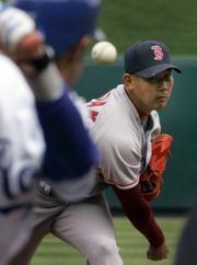 BOSTON's DAISUKE MATSUZAKA throws to Kansas City's Tony Pena Jr. Matsuzaka threw seven strong innings Thursday in a 4-1 victory at Kauffman Stadium.