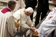 Pope Benedict XVI washes the foot of an unidentified layman Thursday in St. John Lateran Basilica in Rome. The pontiff bathed the feet of 12 laymen, a tradition symbolizing humility, during a busy week of several public appearances.
