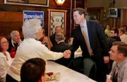 Republican presidential hopeful Sen. Sam Brownback, R-Kan., greets supporters during a campaign luncheon Thursday at the Drake Restaurant in Burlington, Iowa.
