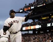 Barry Bonds acknowledges the crowd after hitting his 735th career home run Wednesday night in San Francisco.