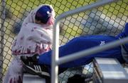Kansas University graduate student Laura Hayes, Lenexa, is enveloped in her blanket as she watches Friday's baseball game between the Jayhawks and the Texas Longhorns at Hoglund Ballpark. Many Jayhawk faithful attended the game in winter attire despite the cold and bitter winds, and more of the same weather is in store today.