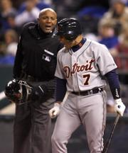 Detroit's Ivan Rodriguez (7) has words with plate umpire C.B. Bucknor after striking out in the fifth inning. The Tigers fell to the Royals, 3-1, on Friday in Kansas City, Mo.