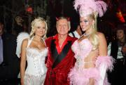 In this photo released by Playboy, from left, Holly Madison, Hugh Hefner and Anna Nicole Smith pose during the 2004 Halloween party at the Playboy Mansion in Los Angeles. Hefner's Playboy will offer three upcoming Smith tributes: a 10-page pictorial in the magazine's May issue, an hourlong retrospective on the Playboy Channel and a memorial on Playboy.com.