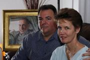 John and Stacey Holley sit by an artist's portrait of their son, Spc. Matthew Holley, at their home in San Diego. Matthew Holley, an Army specialist, was killed in 2005 in Iraq.