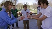 "Cali Burke, 17, left, plays scissors against Tony Thompson&squot;s, 17, rock as Weston Allen, 17, the ""Brigadier General"" of the Lawrence High School&squot;s Rock, Paper, Scissors Club, referees.  The Rock, Paper, Scissors tournament between LHS and Free State High was held Saturday morning in the South Park gazebo."
