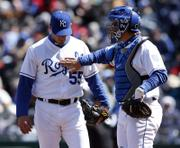 KANSAS CITY ROYALS CATCHER JOHN BUCK gives pitcher Gil Meche some encouragement after Meche allowed a fifth-inning home run to Detroit's Curtis Granderson. The Tigers earned a 6-5 victory Saturday at Kauffman Stadium in Kansas City, Mo.