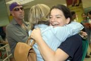 Claire Chevrier, right, of Boca Raton, Fla., is greeted Saturday by a friend after her arrival at Miami International Airport. Claire had been aboard the Sea Diamond, a Greek-flagged cruise ship that hit a reef and sank Thursday off an Aegean Sea island. Nearly 1,600 people were retrieved from the sinking ship in a three-hour rescue operation after the vessel foundered on a volcanic reef.
