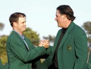 Zach Johnson, left, is congratulated by last year's champion, Phil Mickelson, during the green-jacket ceremony. Johnson won the 2007 Masters on Sunday in Augusta, Ga.