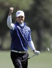 Zach Johnson reacts after chipping in for birdie on the eighth hole. Johnson shot a 3-under 69 in Sunday's final round of the Masters in Augusta, Ga.
