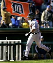Detroit's Ivan Rodriguez rounds the bases after hitting a three-run home run. Rodriguez's ninth-inning blast provided the Tigers' only runs Sunday, but it was enough to edge the Royals, 3-2, in Kansas City, Mo.