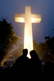 Shortly before daybreak Sunday, John Dreyer and his girlfriend, Carol Davidson, join several hundred worshippers gathered on San Francisco's Mount Davidson for the 85th Annual Easter Sunrise Service.
