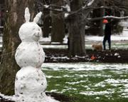 An Easter snow bunny keeps watch over the town square Sunday in Hudson, Ohio.
