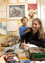 Lora Jost and her son Nicholai Jost-Epp, 5, also are part of the exhibit, which explores the connection between art and mothering. Jost and her son are pictured in a space that Nicholai uses to do his artwork.