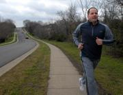 "Toby Eastland, who will be running in the Lawrence Half-Marathon on Sunday, runs Wednesday along South Inverness Drive. ""I have been training since November and I'm excited to run a race that's proceeds will go to help people who don't have health insurance"" Eastland said. The Lawrence Half-Marathon & 5K will take place this year instead of the Raintree Run."