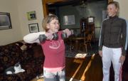 Sue Kapfer, left, who has multiple sclerosis, does some exercises with free weights with her personal trainer, Becky Bridson. Kapfer has been working with Bridson for more than a year and has increased her strength and coordination.