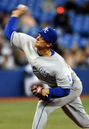 KANSAS CITY'S ZACK GREINKE throws a pitch against Toronto. Greinke earned the win Tuesday in the Royals' 6-3 victory at the Rogers Centre.