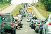 The Wakarusa Music & Camping Festival kicked off with a massive traffic jam in June 2006. Security checks at the festival entry point were blamed for the traffic jam June 8 that had Clinton Parkway and Kansas Highway 10 backed up for several hours.