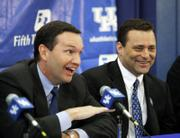 Gillispie, right, laughs as he listens to UK athletic director Mitch Barnhart at a news conference announcing Gillispie's hiring.