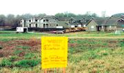 A sign shows a public hearing is scheduled for property on Eisenhower Drive in west Lawrence. Housing and retail development has boomed in the areas near Sixth Street and Wakarusa Drive since Free State High School opened in fall 1997.