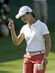 LORENA OCHOA WAVES TO THE GALLERY after finishing her second round at the Ginn Open. Ochoa shot a 6-under 66 on Friday at Reunion, Fla., good for a share of the lead.