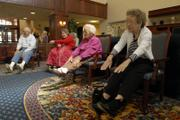 Pioneer Ridge Retirement Community residents, from left, Les Davis, Beverly Edwards, Josephine Mummert and Lucille Lamer stretch during an afternoon workout in the activities room on Thursday. Moving into a long-term care facility can contribute to depression in older adults, but officials say efforts are being made to keep residents active and and help them cope as their lives change.