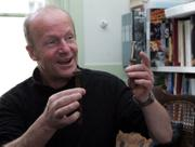 "British novelist Jim Crace uses a rusted bolt to illustrate the impermanence of technology during an interview in London. Crace&squot;s newest work, ""The Pesthouse,"" envisions a post-apocalyptic America in which survivors emigrate to Europe."