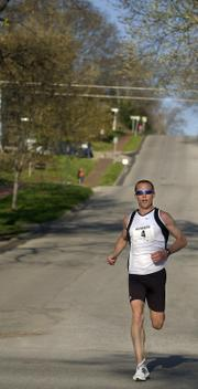 Jason McCullough, Fort Hays State track and field coach, runs downhill during the Lawrence Half-Marathon.  McCullough won the race Sunday.