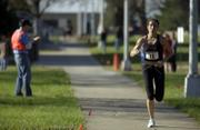 Melissa Todd, of Manhattan, competes in the Lawrence Half-Marathon. Todd took first place in the women's division.