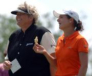 Laura Davies, left, and Lorena Ochoa share a laugh while waiting to tee off on the seventh hole during the third round of the Ginn Open golf tournament. The two were tied for the lead Saturday in Reunion, Fla.