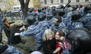 Riot police officers detain opposition demonstrators during a protest Saturday in Moscow. Police detained Russian opposition leader Garry Kasparov, the former world chess champion, and at least 170 other activists as they gathered for a forbidden anti-Kremlin demonstration in central Moscow. Kasparov was freed after being fined $38 for participating in the rally.