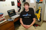 "Emerson Spartz, a Notre Dame University sophomore, sits in his dorm room next to a computer displaying his Harry Potter Web site, mugglenet.com, in South Bend, Ind. Fans across the world are reflecting upon the Potter craze that started eight years ago as the book series ends this summer with ""Harry Potter and the Deathly Hallows."""