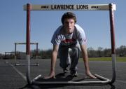 """Lawrence High senior James Taylor will compete in this week's Kansas Relays as a middle-distance hurdler and runner. Nicknamed """"England,"""" Taylor moved with his family from England to Lawrence for his senior year."""