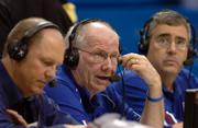 From left, Jayhawk Radio Network announcers Chris Piper and Bob Davis call a Kansas University basketball game with the assistance of producer-engineer Bob Newton. Kansas Athletics Inc. signed a 10-year, $65 million marketing and media pact with Host Communications Inc., in collaboration with ESPN Regional. The radio team worked at the KU-Washburn University game Nov. 2 at Allen Fieldhouse.