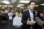 Republican presidential hopeful U.S. Sen. Sam Brownback, R-Kan., talks to media during a campaign visit to a Catholic bookstore in Des Moines, Iowa. Brownback's campaign swing Monday touched on his plan for a flat tax on incomes.