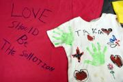 These two T-shirts from the Clothes-line project represent two victims of abuse. The Clothesline Project will also be on display Saturday at the Earth Day celebration in South Park.