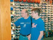 Ian Nichols and his father, John, shop at Francis Sporting Goods, 731 Mass., Sunday. The Nichols were looking for a pair of football shoes.