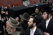 The casket of Liviu Librescu is carried through the street in Brooklyn, New York. Librescu, who was a Holocaust survivor and teacher at Virginia Tech, was killed on Monday during the massacre of 32 people by a student gunman.