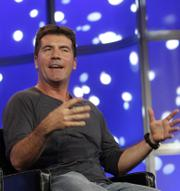 """American Idol"" judge Simon Cowell speaks during the 2007 Fox Winter Press Tour in this Jan. 20 file photo in Pasadena, Calif. An annoyed look from Cowell as a contestant expressed sadness over the Virginia Tech shootings was misinterpreted, Cowell and the show said Wednesday."