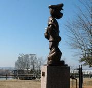 "A statue of Popeye stands by the ""secret"" bridge across the Mississippi River near Chester, Ill. The statue is a tribute to Elzie Segar (1894-1938), Popeye&squot;s creator who was born and raised in Chester."