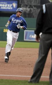 Kansas City&#39;s Ross Gload rounds third base. Gload hit a two-run homer to put the Royals on the board. 