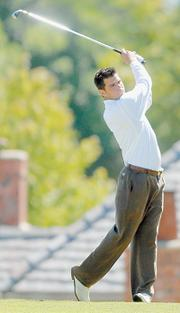 Kansas University's Gary Woodland tees off. Woodland, known for his long drives, has been working on his short game in preparation for the Big 12 Championships, which takes place today and Tuesday at Prairie Dunes in Hutchinson.