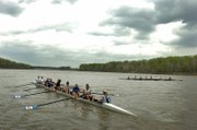 Members of the Kansas Women's Rowing Team embark on an afternoon of practice underneath overcast skies. The Kansas River will be the subject of a nine-day study next month by the Kansas Riverkeeper and volunteers to help chart both the beautiful and the problem areas of the Kaw.