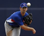 Chicago's Mark Prior delivers against San Diego during a spring-training game in Peoria, Ariz. The Cubs hurler will miss the 2007 season following surgery on his right shoulder.