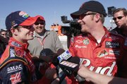"Jeff Gordon, left, and Dale Earnhardt Jr. share a joke following a race in 2003. Speaking on their relationship, Gordon says, ""We have a lot of respect on the track."""
