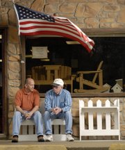 Michael Wooden, left, owner of Wooden's Outdoor Furniture in Perry, and his father-in-law, Gary Jump, Lawrence, who helps out at the store, are closing the store Friday. Wooden says the dramatic drop in business because of the closing of the Lecompton bridge for repairs convinced him to close up shop. Wooden and Jump were at the store Wednesday.