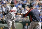 Minnesota reliever Dennys Reyes, left, hands the ball to manager Ron Gardenhire. Reyes, a situational lefty, put up one of the best LOOGY seasons of all time in 2006.