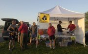 Runners check in at the registration tent before the Vasque Free State Trail Runs by the north shore of Clinton Lake. Runners looped a 21-mile trail to complete their runs Saturday.